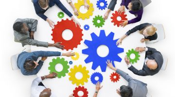 Business People with Gears and Teamwork Concept